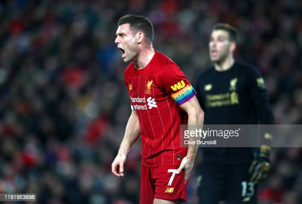 James Milner of Liverpool wears a Stonewall Rainbow Laces captains arm band during the Premier League match between Liverpool FC and Everton FC at...