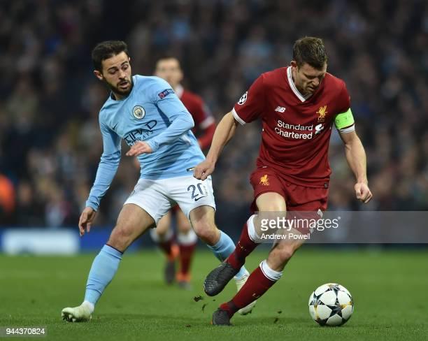 James Milner of Liverpool with Bernardo Silva of Manchester City during the UEFA Champions League Quarter Final Second Leg match between Manchester...