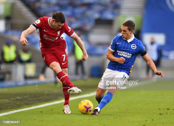 James Milner of Liverpool with Brighton & Hove Albion's Leandro Trossard during the Premier League match between Brighton & Hove Albion and Liverpool...