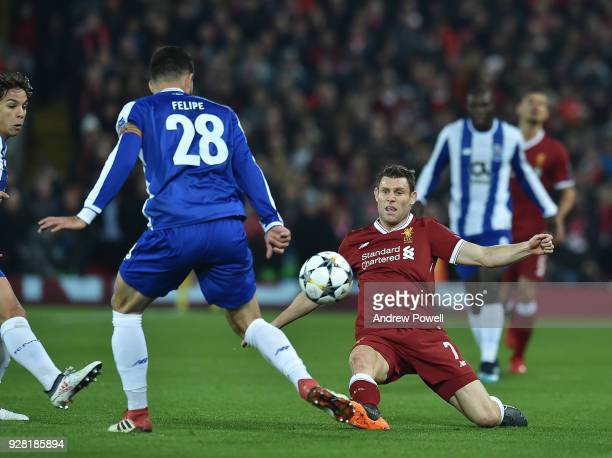 James Milner of Liverpool with Felipo of FC Porto during the UEFA Champions League Round of 16 Second Leg match between Liverpool and FC Porto at...