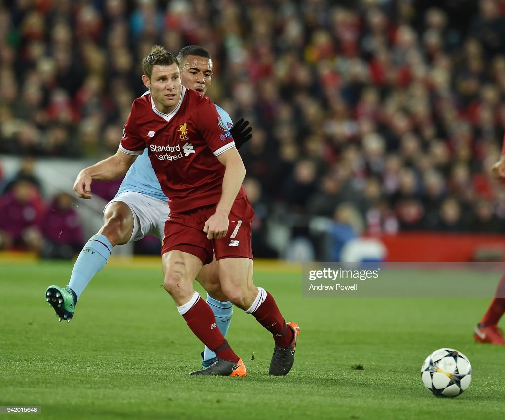 James Milner of Liverpool with Gabriel Jesus of Manchester city during the UEFA Champions League Quarter Final Leg One match between Liverpool and Manchester City at Anfield on April 4, 2018 in Liverpool, England.