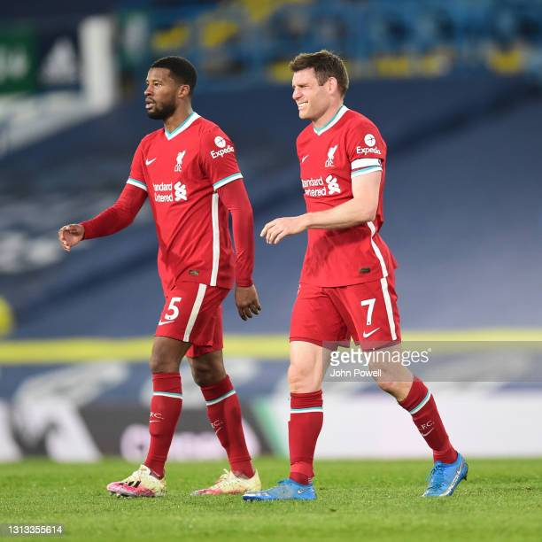 James Milner of Liverpool with Georginio Wijnaldum of Liverpool at the end of the Premier League match between Leeds United and Liverpool at Elland...