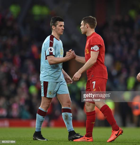 James Milner of Liverpool with Joey Barton of Burnley at the end of Premier League match between Liverpool and Burnley at Anfield on March 12 2017 in...