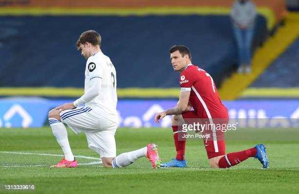 James Milner of Liverpool with Patrick Bamford of Leeds United Take to the knee before the Premier League match between Leeds United and Liverpool at...