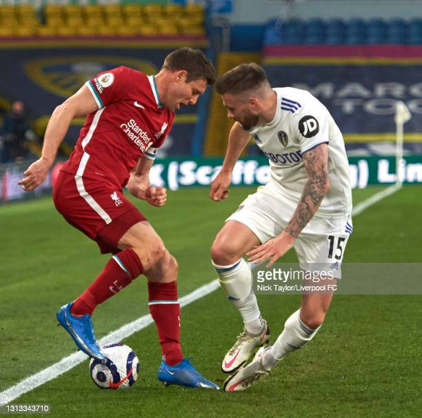 James Milner of Liverpool with Stuart Dallas of Leeds United during the Premier League match between Leeds United and Liverpool at Elland Road on...