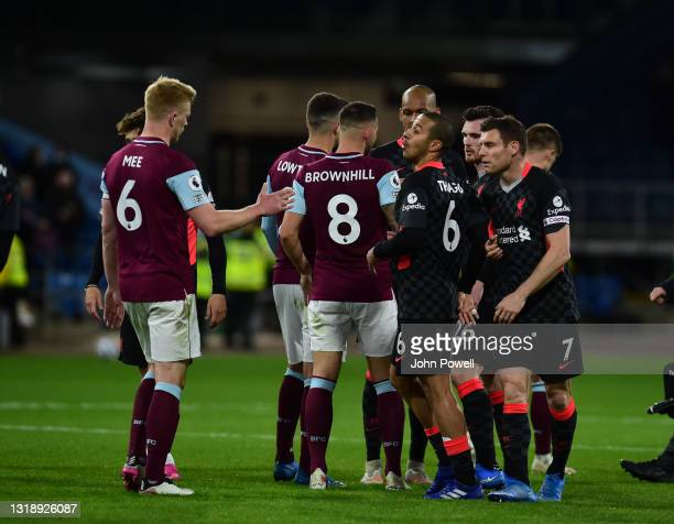 James Milner of Liverpool with Thiago Alcantara of Liverpool at the end of the game eague match between Burnley and Liverpool at Turf Moor on May 19,...