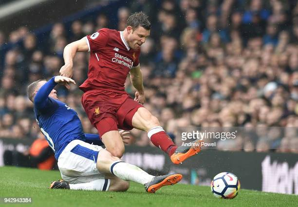 James Milner of Liverpool with wayne Rooney of Everton during the Premier League match between Everton and Liverpool at Goodison Park on April 7 2018...