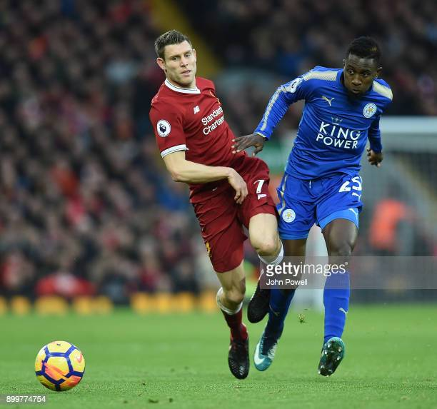 James Milner of Liverpool with Wilfred Ndidi of Leicester City during the Premier League match between Liverpool and Leicester City at Anfield on...