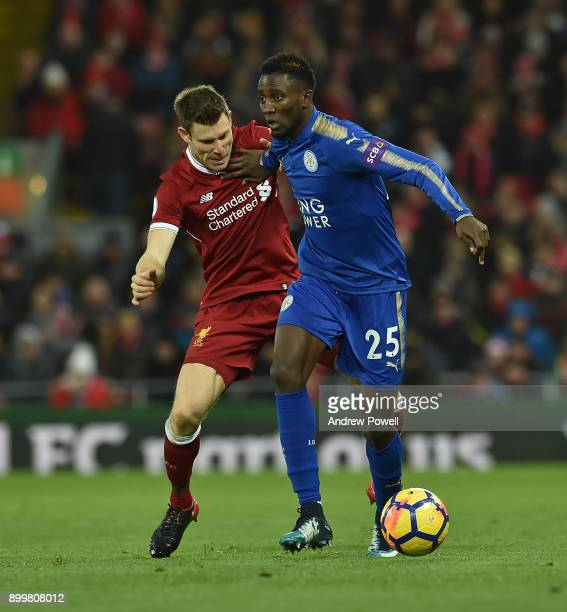 James Milner of Liverpool with With Wilfred Ndidi of Leicester City during the Premier League match between Liverpool and Leicester City at Anfield...