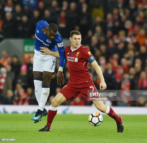 James Milner of Liverpool With Yannick Bolasie of Everton during The Emirates FA Cup Third Round match between Liverpool and Everton at Anfield on...