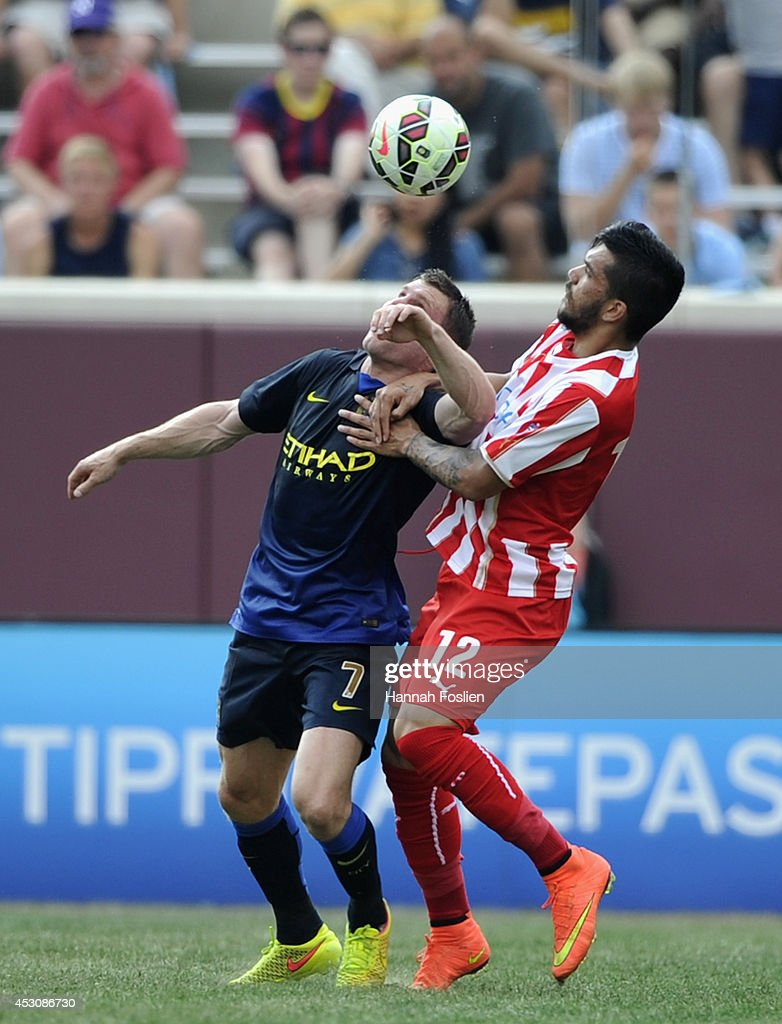 James Milner #7 of Manchester City and Dimitrios Kolovos #12 of Olympiacos go for the ball during the second half of the International Champions Cup match on August 2, 2014 at TCF Bank Stadium in Minneapolis, Minnesota. The Olympiacos defeated the Manchester City in a penalty shootout.
