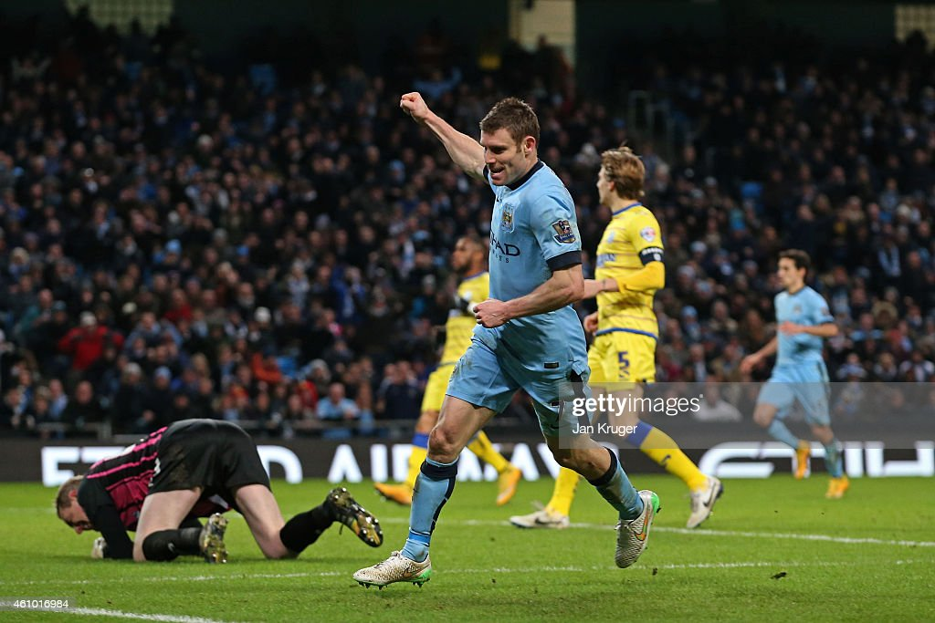 James Milner of Manchester City celebrates after scoring a goal to level the scores at 1-1 during the FA Cup Third Round match between Manchester City and Sheffield Wednesday at Etihad Stadium on January 4, 2015 in Manchester, England.