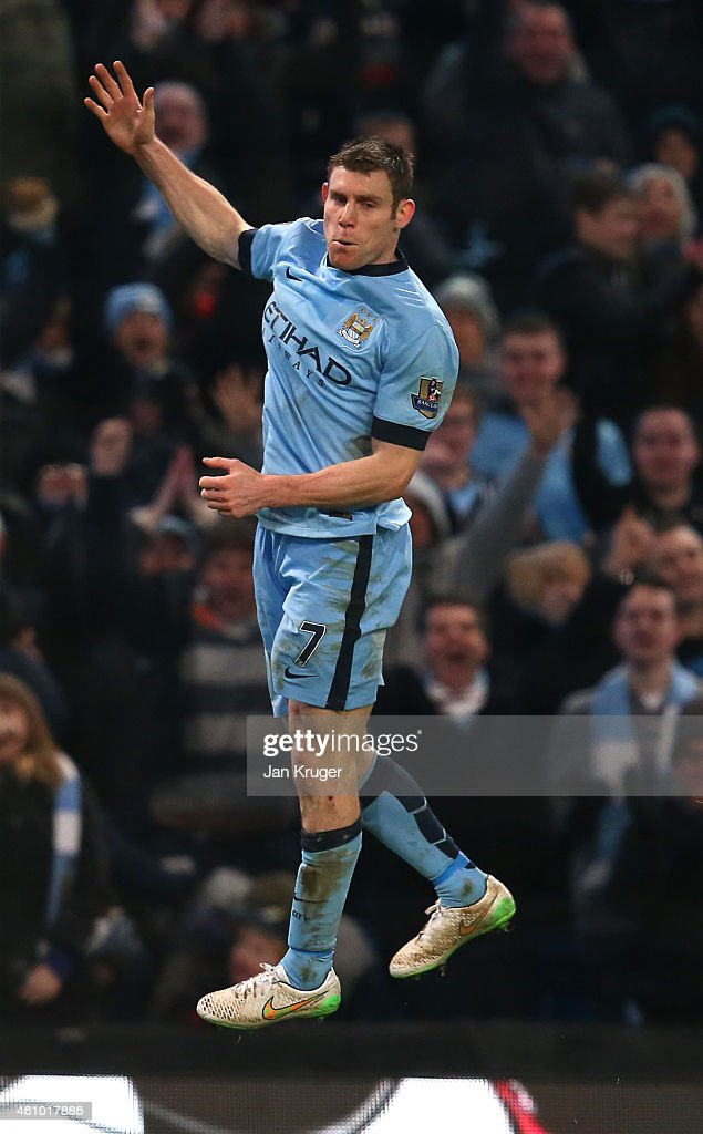 James Milner of Manchester City celebrates after scoring his team's second goal to take a 2-1 lead during the FA Cup Third Round match between Manchester City and Sheffield Wednesday at Etihad Stadium on January 4, 2015 in Manchester, England.