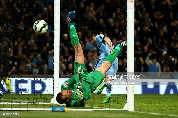 James Milner of Manchester City celebrates after scoring his team's second goal past goalkeeper Mark Schwarzer of Leicester City during the Barclays...