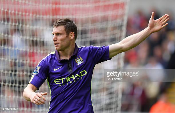 James Milner of Manchester City celebrates after scoring his team's second goal during the Barclays Premier League match between Swansea and...
