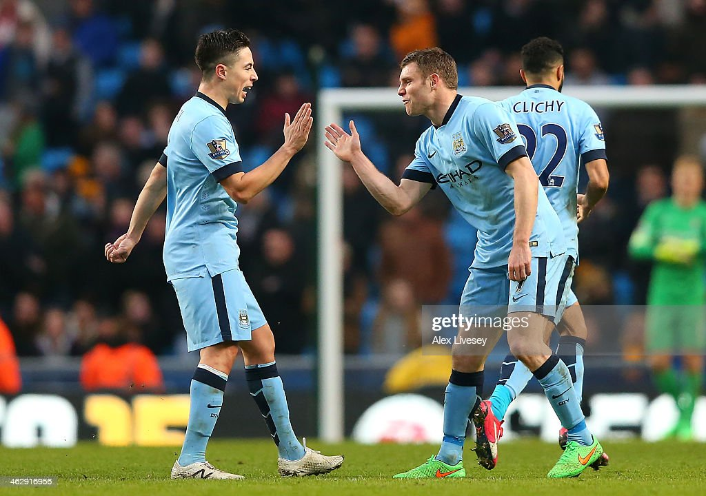 James Milner (R) of Manchester City celebrates scoring the equalising goal with team-mate Samir Nasri during the Barclays Premier League match between Manchester City and Hull City at the Etihad Stadium on February 7, 2015 in Manchester, England.