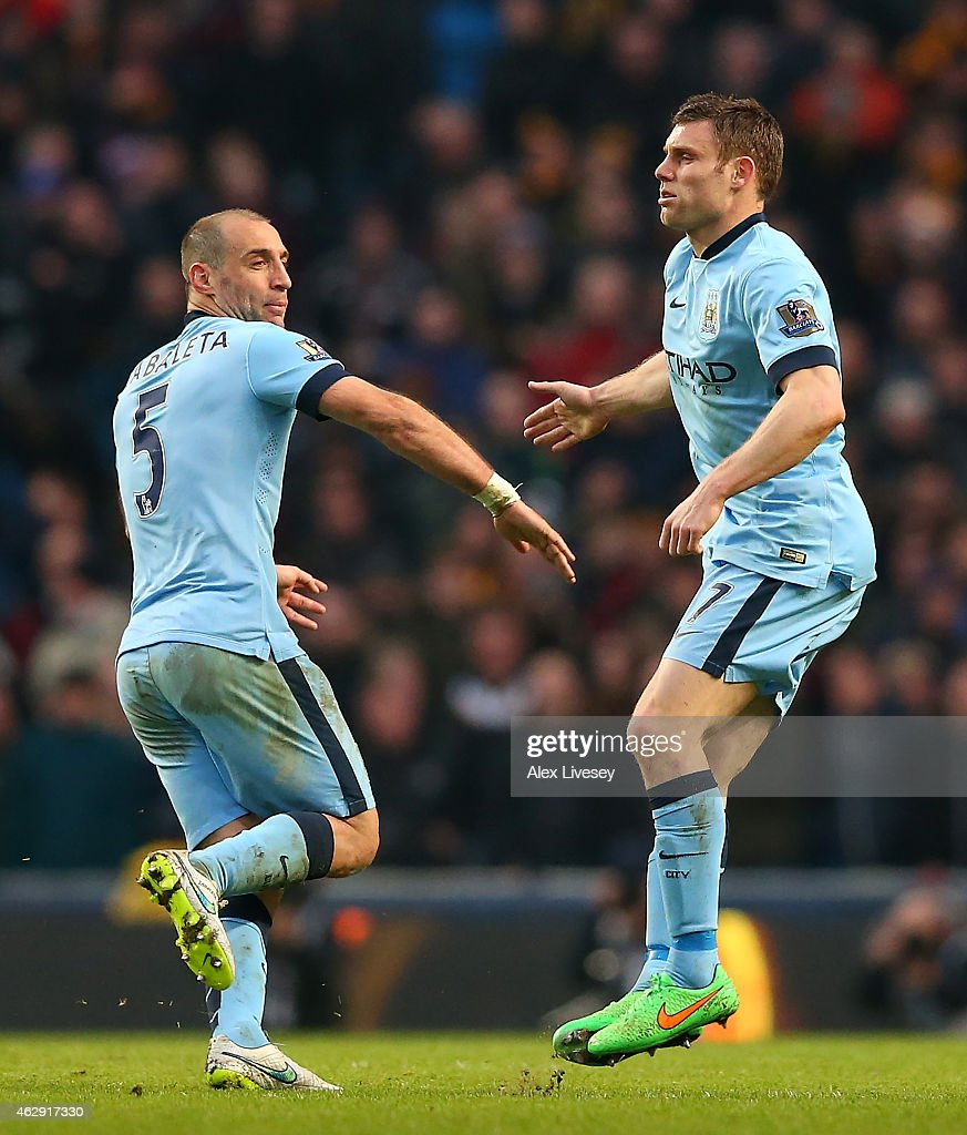 James Milner (R) of Manchester City celebrates scoring the equalising goal with team-mate Pablo Zabaleta during the Barclays Premier League match between Manchester City and Hull City at the Etihad Stadium on February 7, 2015 in Manchester, England.