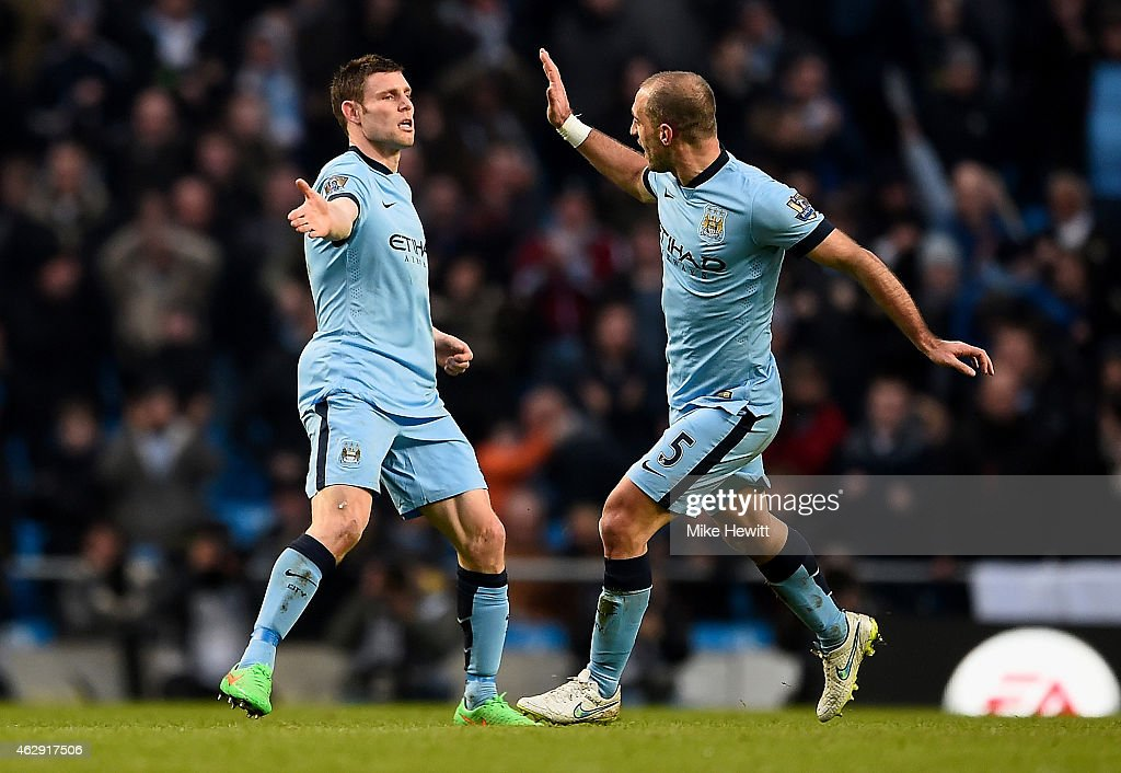James Milner (L) of Manchester City celebrates scoring the equalising goal with team-mate Pablo Zabaleta during the Barclays Premier League match between Manchester City and Hull City at the Etihad Stadium on February 7, 2015 in Manchester, England.