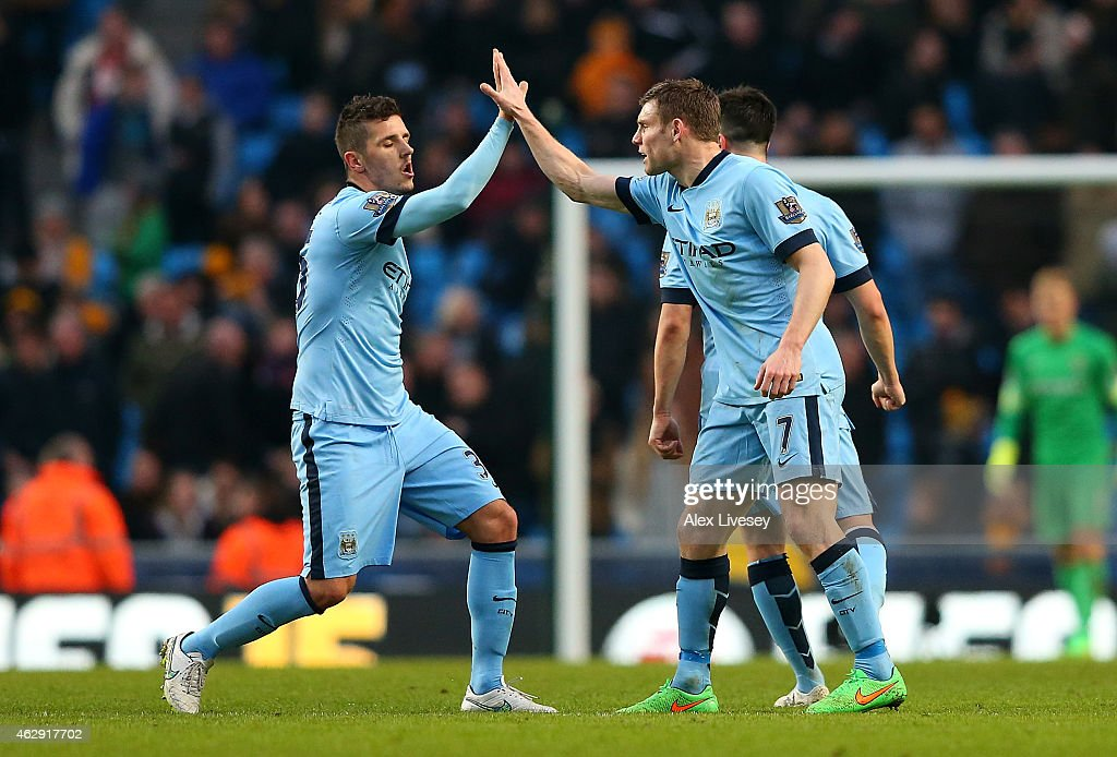 James Milner (R) of Manchester City celebrates scoring the equalising goal with team-mate Stevan Jovetic during the Barclays Premier League match between Manchester City and Hull City at the Etihad Stadium on February 7, 2015 in Manchester, England.