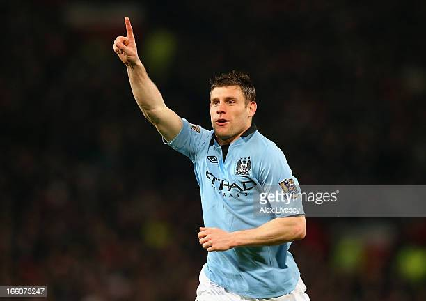 James Milner of Manchester City celebrates scoring the opening goal during the Barclays Premier League match between Manchester United and Manchester...
