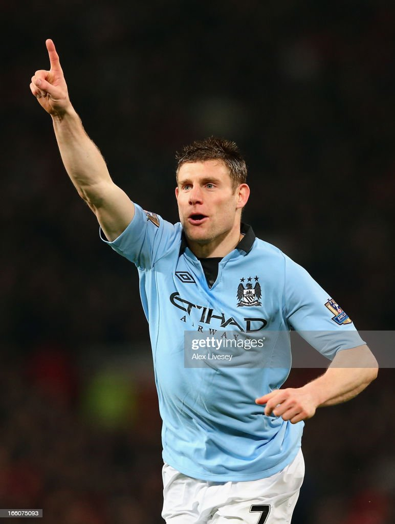 James Milner of Manchester City celebrates scoring the opening goal during the Barclays Premier League match between Manchester United and Manchester City at Old Trafford on April 8, 2013 in Manchester, England.