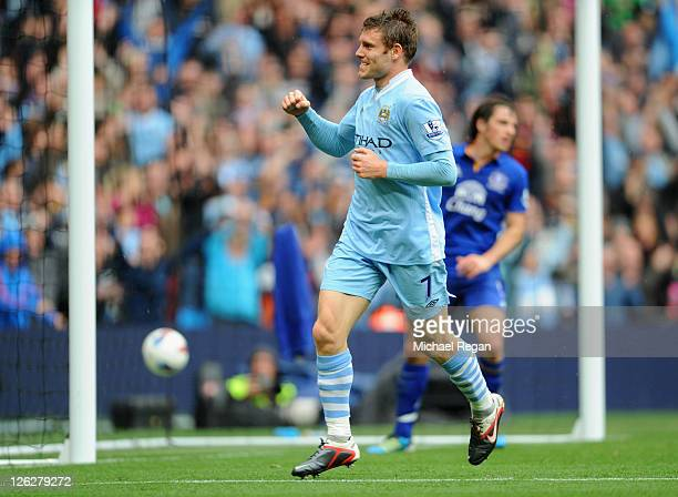 James Milner of Manchester City celebrates scoring to make it 2-0 during the Barclays Premier League match between Manchester City and Everton at the...