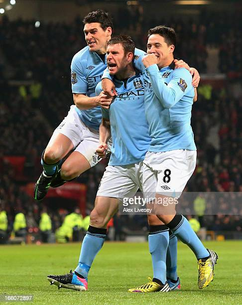 James Milner of Manchester City celebrates with his teammates Gareth Barry and Samir Nasri after scoring the opening goal during the Barclays Premier...