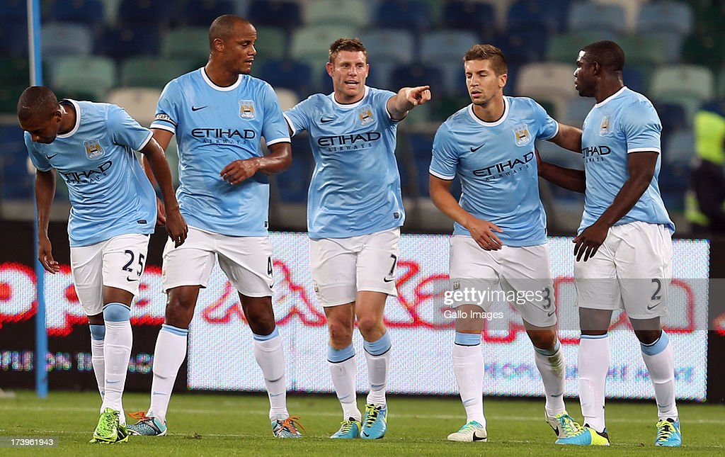 James Milner of Manchester City points to the bench after his goal during the Nelson Mandela Football Invitational match between AmaZulu and Manchester City at Moses Mabhida Stadium on July 18, 2013 in Durban, South Africa.