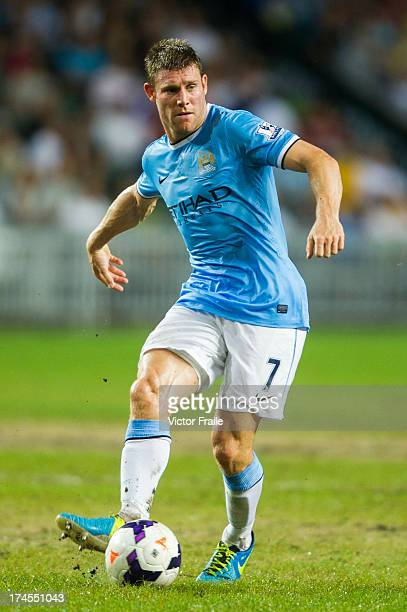 James Milner of Manchester City runs with the ball during the Barclays Asia Trophy Final match between Manchester City and Sunderland at Hong Kong...