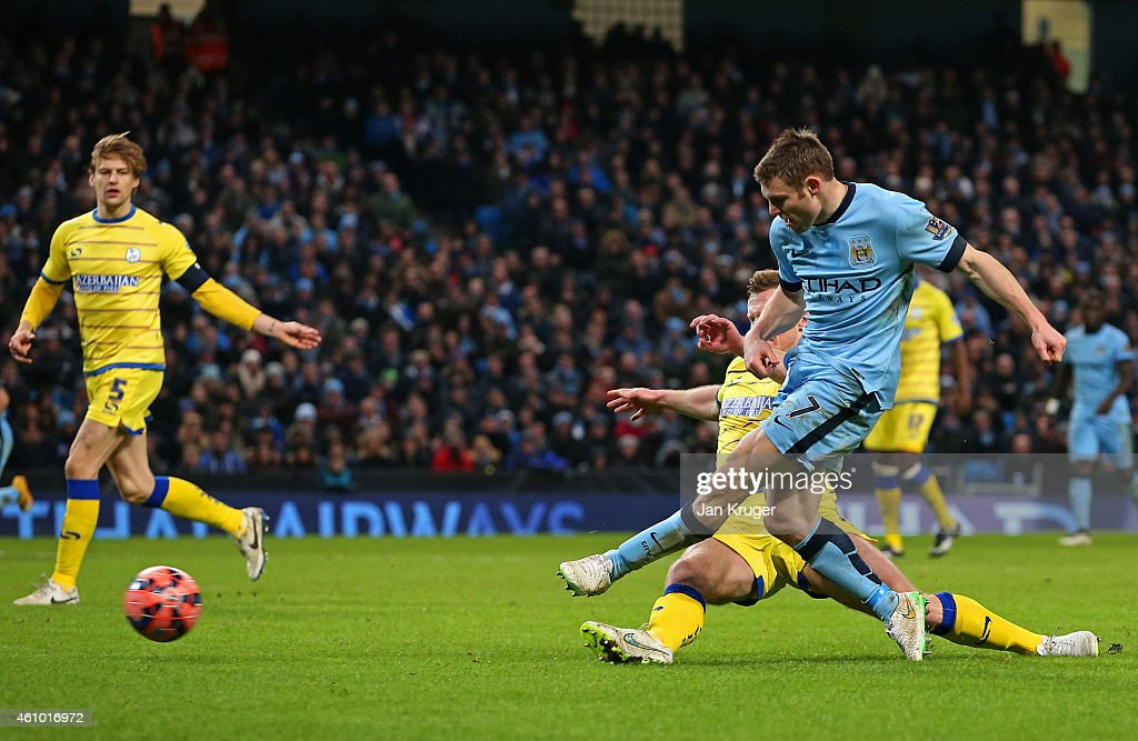 James Milner of Manchester City scores a goal to level the scores at 1-1 during the FA Cup Third Round match between Manchester City and Sheffield Wednesday at Etihad Stadium on January 4, 2015 in Manchester, England.