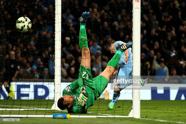 James Milner of Manchester City scores his team's second goal past goalkeeper Mark Schwarzer of Leicester City during the Barclays Premier League...