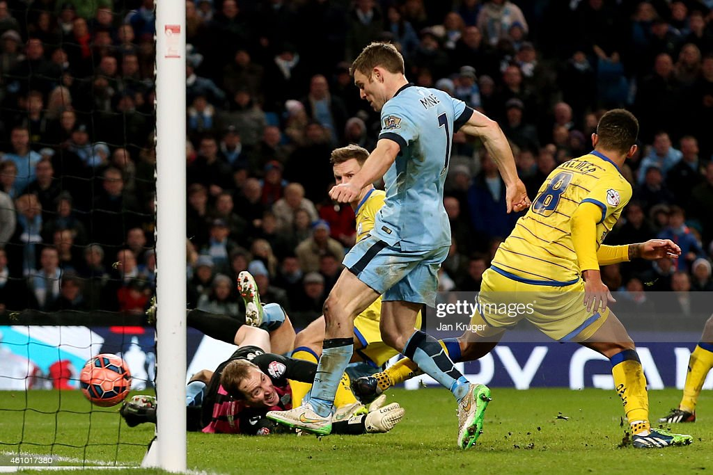 James Milner of Manchester City scores his team's second goal to take a 2-1 lead during the FA Cup Third Round match between Manchester City and Sheffield Wednesday at Etihad Stadium on January 4, 2015 in Manchester, England.