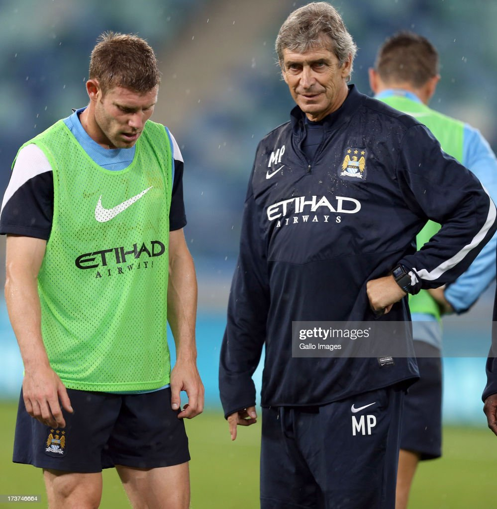 James Milner of Manchester City with Manuel Pellegrini Manger of Manchester City during the Manchester City training session at Moses Mabhida Stadium on July 17, 2013 in Durban, South Africa.