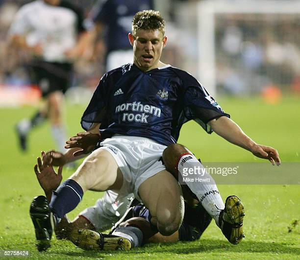 James Milner of Newcastle United is tackled during the Barclays Premiership match between Fulham and Newcastle United at Craven Cottage on May 4 2005...