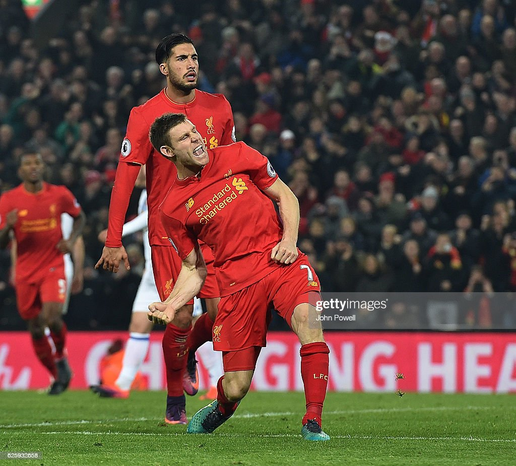James Milner scores from the penalty spot for Liverpool and celebrates during the Premier League match between Liverpool and Sunderland at Anfield on November 26, 2016 in Liverpool, England.