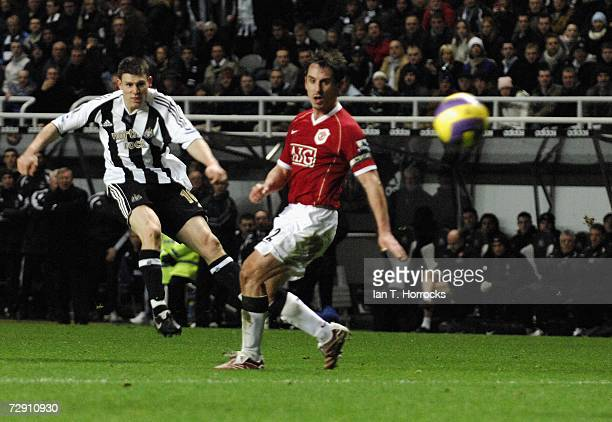 James Milner scores Newcastle's opening goal during the Barclays Premiership match between Newcastle United and Manchester United at St James' Park...