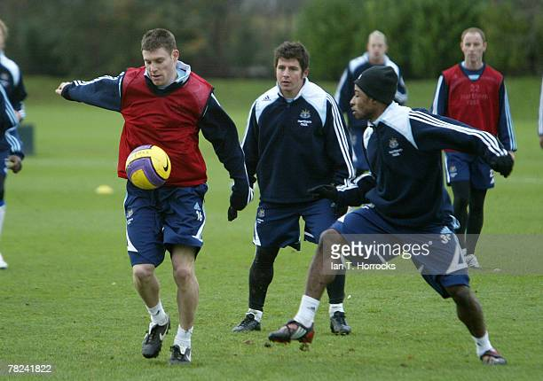James Milner under pressure from Tresor Lua Lua during a Newcastle United training session at the Little Benton training ground on December 4 2007 in...