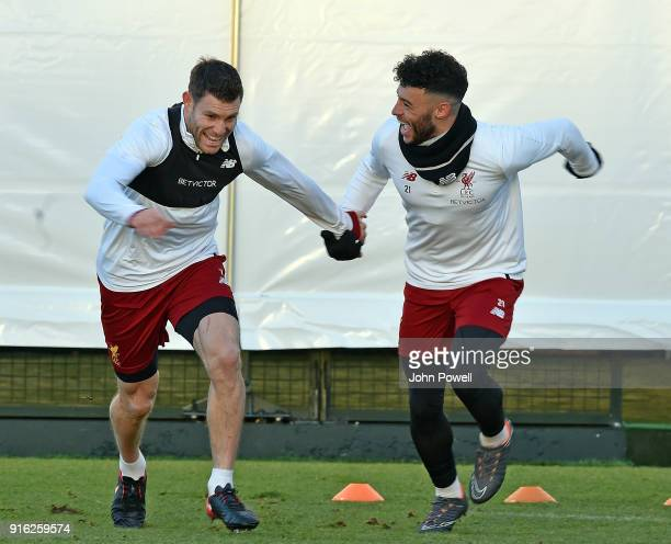 James Milner with Alex OxladeChamberlain of Liverpool during a training session at Melwood Training Ground on February 9 2018 in Liverpool England