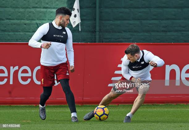 James Milner with Alex OxladeChamberlain of Liverpool during a training session at Melwood Training Ground on March 13 2018 in Liverpool England