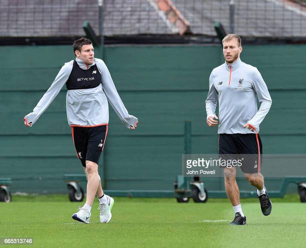 James Milner with Ragnar Klavan of Liverpool during a training session at Melwood Training Ground on April 6 2017 in Liverpool England