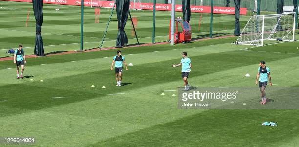 James MilnerTrent AlexanderArnoldDejan Lovren and Virgil van Dijk of Liverpool during a training session at Melwood Training Ground on May 20 2020 in...