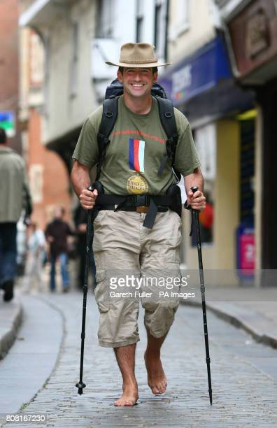 James Milton a former Army captain arrives in Canterbury Kent as he completes a 130mile barefoot charity walk from Winchester cathedral to Canterbury...