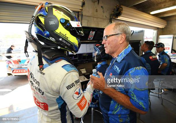James Moffat driver of the Wilson Security Racing GRM Holden Commodore VF is congratulated by Garry Rogers team owner of GRM during the top ten...