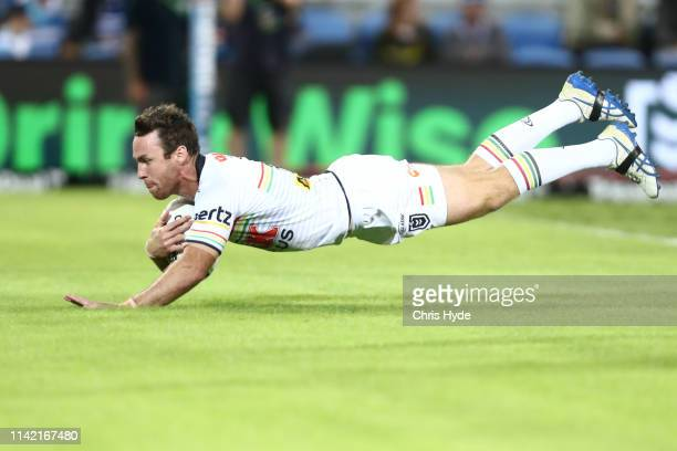 James Moloney of the Panthers scores a try during the round five NRL match between the Gold Coast Titans and the Penrith Panthers at Cbus Super...