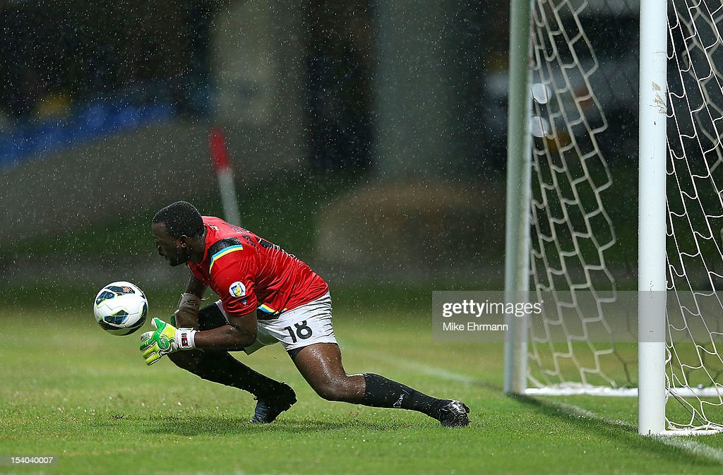 James Molvin Alfanson of Antigua and Barbuda makes a save during a World Cup Qualifying game against the United States at Sir Vivian Richards Stadium on October 12, 2012 in Antigua, Antigua and Barbuda.