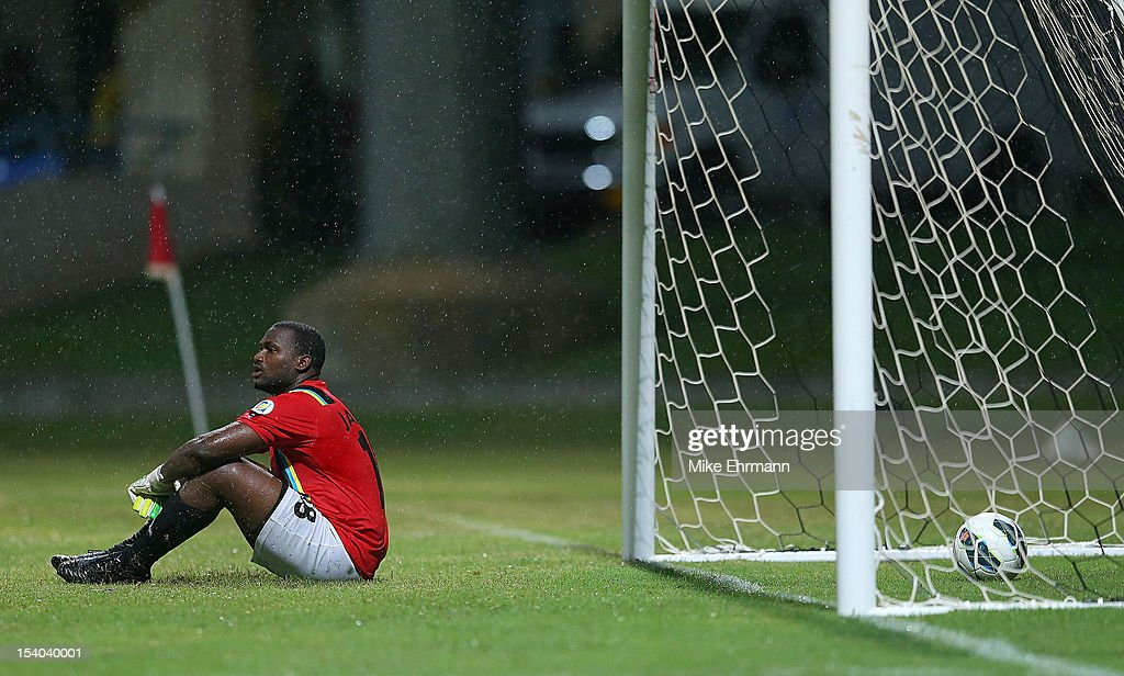 James Molvin Alfanson of Antigua and Barbuda reacts to giving up the go ahead goal during a World Cup Qualifying game against the United States at Sir Vivian Richards Stadium on October 12, 2012 in Antigua, Antigua and Barbuda.