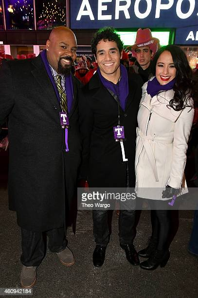 James Monroe Iglehart Adam Jacobs and Courtney Reed of Aladdin on Broadway attend New Year's Eve 2015 at Times Square on December 31 2014 in New York...