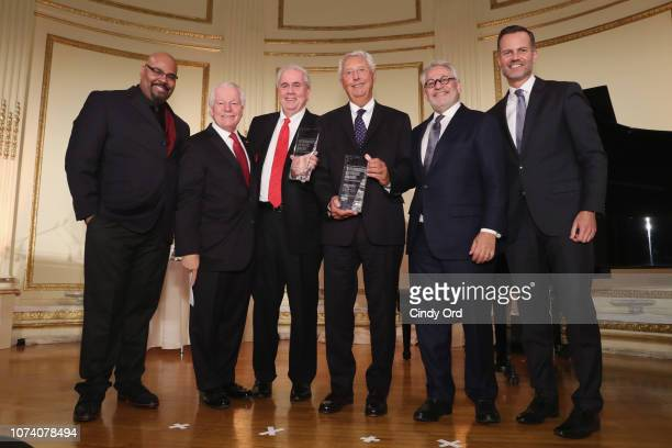 James Monroe Iglehart Roger Dow honorees Mike Gallagher and Mike Morey Charlie Flateman and Fred Dixon pose onstage during the NYC Company Foundation...