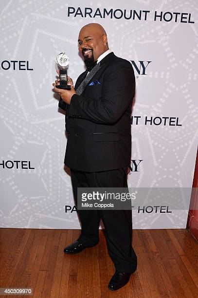 "James Monroe Iglehart winner of the award for Best Performance by an Actor in a Featured Role in a Musical for ""Aladdin"" poses in the Paramount Hotel..."
