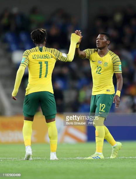 James Monyane of South Africa celebrates with team mate Thakgalo Leshabela of South Africa after scoring their team's first goal from the penalty...